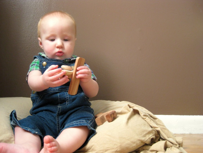 7 Month Baby Photo with wooden Toy